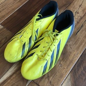 Bright yellow Adidas soccer cleats